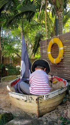 two little pirates....: The old boat sand pit or as it's being called on Pinterest, the sand box!