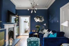 [New] The 10 Best Home Decor (with Pictures) - Bright white brings the (moon)light to midnight-blue rooms. Silver linings come in the form of metallic cushions reflective hexagons mirror-fronted cupboards and glass lanterns and table tops. Navy Living Rooms, Dark Blue Living Room, Blue Living Room Decor, Glam Living Room, Eclectic Living Room, Living Room Colors, Living Room Grey, Living Room Interior, Living Room Designs
