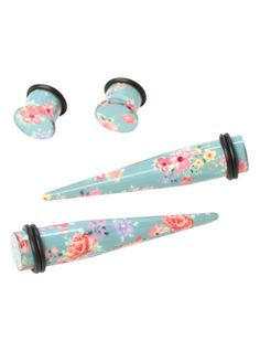 A pair of light blue pink floral designed tapers, a matching pair of plugs and black O-rings.