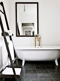 Tub: I think having a tub seperate from the shower is a way to show how the bathroom looked before the shower was invented. The faucet would stay gold to match the faucet of the sink.  Ladder Shelf: I feel that this is a way of making the bathroom look open and less cluttered or closed off.