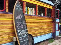 """surfboard menu...ok, so this is not a sports car like the rest but a """"Woody"""" bus gone cafe.  A new take on the food truck."""