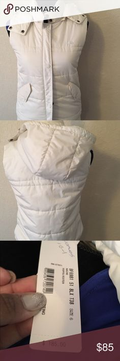 Lacoste Vest White Puffer Lacoste Vest! 100% authentic ! Vest has a zipper and snaps to close the front and a hood with two drawstrings! See photo for purchase price! This is a great item for cold weather, skiing, etc! Lacoste Jackets & Coats Vests