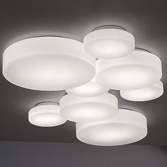 The Makeup Wall/Ceiling Light was designed and made by Studio Italia Design. This light features a simplistic design of a round and compact fixture with a metal frame and blown glass shade in matte white. The blown glass diffuser helps to evenly d. Modern Lighting, Lighting Design, Italia Design, Indoor Wall Sconces, Wall Lights, Ceiling Lights, Glass Diffuser, Flush Mount Lighting, Ceiling Fixtures