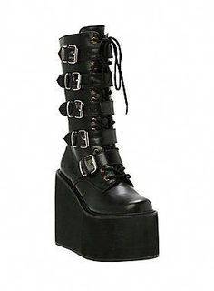 17fbb0bd2f61 Black PU lace-up boots buckled straps and side zip closure. 16