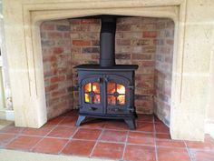 Refurbd Yeoman stove with limestone surround, tapered brick chamber and quarry tile hearth. Wood Burner Fireplace, Craftsman Fireplace, Farmhouse Fireplace, Brick Fireplace, Foyers, Images Of Fireplaces, Wood Stove Surround, Fireplace Gallery, Hearth Stone
