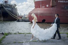 A wedding couple photographed at Polson Pier in Toronto! Gorgeous wedding dress, and of course amazing bride and groom :) www.sarunia.com
