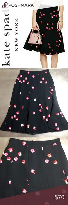 Kate Spade Falling Floral Skirt Kate Spade Falling Floral Skirt featuring an invisible zip closure, knee length, beautiful black skirt with red, pink & white floral print.  Fully Lined 100% Polyester  Size 2 Excellent Pre-Loved Condition ❤️ kate spade Skirts A-Line or Full