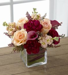 I like the shape, not purple enough tho Small Flower Centerpieces, Burgundy Floral Centerpieces, Wedding Floral Arrangements, Short Wedding Centerpieces, Square Vase Centerpieces, Small Flower Arrangements, Small Vases With Flowers, Centrepieces, Cranberry Centerpiece