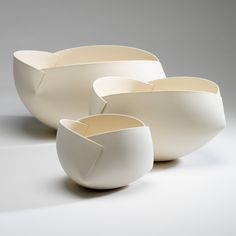 'Growing' by Ann Van Hoey, 2009.  These delicate white earthenware vessels are like folded egg shells. Beautiful.
