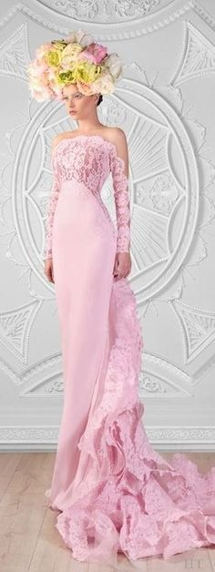 Rami Kadi 2014 ht. Just my humble opinion but I'm not crazy about the headdress or the color but the flow of the gown is beautiful.