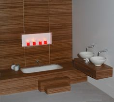 Wonderfully modern bespoke bathroom created by Elf Miniatures as a commission for a client. There is a false back wall with a niche for candle lights. The back wall and dais housing for the sunken bath are made from zebrano and the matching vanity unit with hand-made white bowls were made by Terry Curran. Visit our website for further idea's and inspirational features www.dollshousemag.co.uk