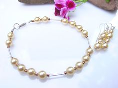 Check out Light Gold Swarovski Pearl with Sterling Silver Tube Beads Bracelet on frisado