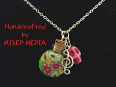 This necklace has a wishing bottle wrapped in polymer clay to keep your wishes private & also it prevents the bottle from breaking.   Put your wish on a piece of paper & place it inside the corked bottle