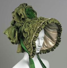 Bonnet, ca 1830 US, the Museum of Fine Arts, Boston  Woman's green silk hat with wide poke bonnet brim and high crown.