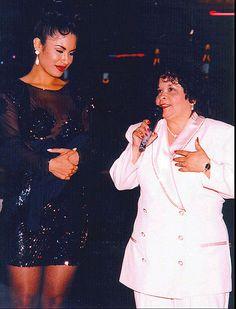 Selena, left, watches as her future murderer Yolanda Saldivar speaks to a crowd