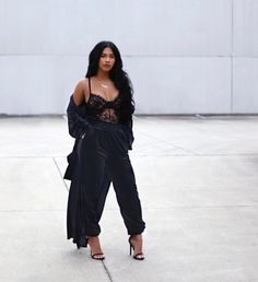 Black on black, black lace bodysuit with black cropped pants. Love this baddie inspo outfit idea.