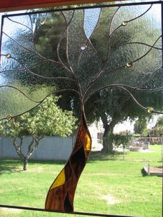 I imagine you could cut faux stained glass and get the same effect if a view is boring.  Tree stained glass.