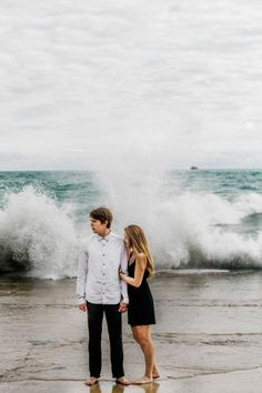Playful Beach Engagement Photos by Eastlyn Bright