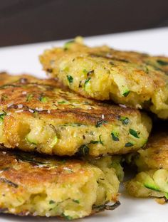 Zucchini Cakes. Freshly shredded zucchini with Parmesan cheese, garlic and spices, pan fried until golden brown. #recipe Pin by Ellesilk.com