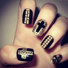 This mix and match of patterns is a great black and gold nail style!