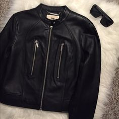 """TODAY ONLY Black Leather Michael Kors Jacket Sad to let this one go.... Brand New With Tags Michael Kors Black Leather Moto Jacket with Silver Embellishments. Jacket measures 20"""" from shoulder to hem. Each zipper on front sides opens up to small pocket. This jacket is just too gorgeous!!!! Make an offer because I know it isn't going to last long on here . MICHAEL Michael Kors Jackets & Coats"""