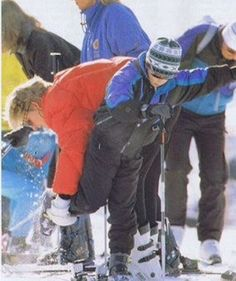 March 26-31, 1993: Lady Diana helps Prince Harry with his ski boots during a ski holiday in Lech.(x)