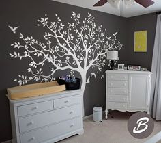 Your walls will stand out with this adorable vinyl wall decal set in a delicate tree design with gorgeous birds.  Wall decals offer an easy and affordable solution to take on those blank walls without the need of hanging wallpaper or painting. Temporary vinyl wall decal is ideal for apartment renters or anyone who loves to decorate.  Standard size for this tree decal is 80.7 wide x 80.7 tall (205cm x 205cm)  SET INCLUDES  1 vinyl wall tree decal and leaves Detailed decal application…