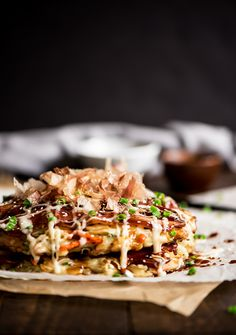 Okonomiyaki - Delightful savory Japanese pancakes made from an easy to make batter, cabbage and bacon topped with Japanese mayo and okonomiyaki sauce. Pancakes And Bacon, Savory Pancakes, Japanese Pancake, Japanese Food, Asian Recipes, Healthy Recipes, Ethnic Recipes, Drink Recipes, Healthy Meals