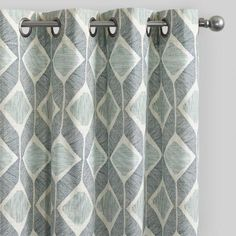 Light, medium and indigo tones of blue come together in a loose diamond pattern for casual yet put-together window dressing. Made with 100% cotton, these curtains hang from gunmetal-gray grommets to allow for privacy when you want it.
