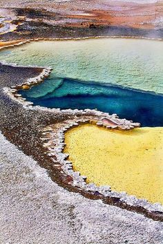 Yellowstone National Park, Wyoming - In the summer, the microbial mats tend to be orange and red, whereas in the winter the mats are usually dark green.