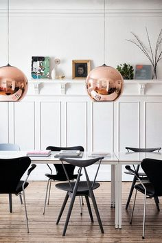 Modern chairs and a Copper Shade pendant light from Tom Dixon for a lovely dining room