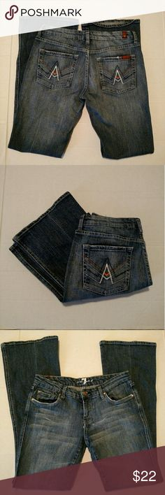 """7 For All Mankind Flare A Pocket 7 For All Mankind A Pocket Dark Wash Boot Cut Style Jeans in great condition.  Womens size 28  98% cotton 2% polyurethane  Top button closure  Zipper fly   5 pocket style  Stretch fit  Approximate measurements flat across with natural dip unstretched  Waist 14 1/4""""  Front rise: 7 1/2""""   Inseam: 31 1/2""""  Bottom Leg opening 9 1/3"""" 7 For All Mankind Jeans Flare & Wide Leg"""