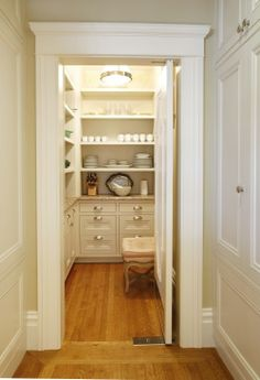 Clean, white pantry - shelves, drawers, and out of the way!