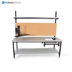 Articulating Monitor Arm on Benchmarx Workbench | FORMASPACE | This Benchmarx workbench was modified with a custom scale cut out, cork board panel, full depth lower shelf, and height adjustable monitor arm.
