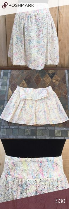 """🆕 Eyelet Lace Skirt Pale yellow background with splashes of light blue, pink & yellow all over.  Eyelet lace skirt is lined. Measurements are 16"""" waist & 16.5"""" long laid flat on table. In excellent condition with NO damage. Theory Skirts"""