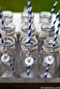 Nautical Birthday Party Ideas. Milk bottles with life savers wrapped around the neck with twine! So cute! http://fantabulosity.com