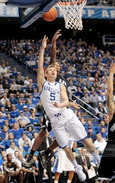 Kentucky's Jarrod Polson (5) scored