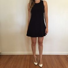 """Black Sleeveless Tunic Mini Dress Black Sleeveless Tunic Dress. Brand new. Never worn. No flaws. Available in S-M-L. Runs true to size. Model is wearing a small for reference. Model is 5'6"""" for reference. 87% polyester, 13% spandex. Bundle for 15% off all 3+ item bundles. No Paypal. No trades. No offers will be considered unless you use the make me an offer feature.    👉 Please follow 📱 Instagram: BossyJoc3y Dresses Mini"""