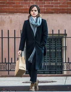 Effortless: Emma Watson wrapped up in stylish layers on Monday as she did a spot of shopping in New York