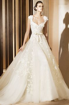 What I wouldn't do for an Ellie Saab dress!
