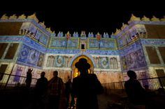 Jun. 12, 2014. An Ultra Orthodox Jewish man watches a light projection show at the Damascus Gate during the Jerusalem Lights Festival, in the Old City of Jerusalem, Israel.