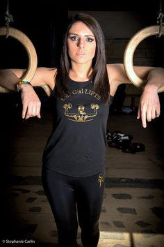 Model wears 'This Girl Lifts' racer back vest in Black and Gold.