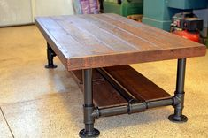 Industrial Barnwood Coffee Table with Steel Pipe Legs with Lower Wood Shelf