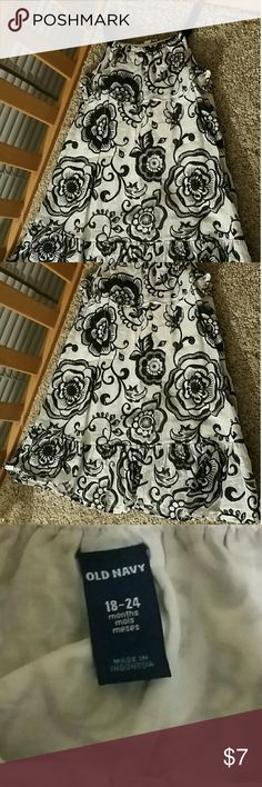 Black and White Floral Girl's Dress White dress with very thin silver stripes and black flowers of various styles and sizes all over.Flared at the bottom and two thin black straps at the top.Floral fun for fall with a jacket,leggings and boots! Old Navy Dresses Casual