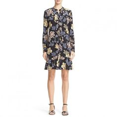 --evaChic--This Tory Burch Jane Floral Silk Shirtdress features all-over tropical floral print which is based on a freehand pastel drawing. The button-down silhouette is accented with a ruffled placket and a flounced hem which make it ultra-feminine. The pearl buttons are subtle luxe details. This is a day-to-evening all-season dress.            http://www.evachic.com/product/tory-burch-jane-floral-silk-shirtdress/