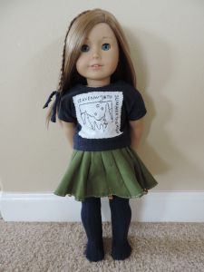American Girl Doll Leavenworth Summer Theater Outfit: Logo T-Shirt, Green Bell Skirt, Blue Tights with Patterns