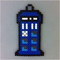 HarmonArt2-This blue police box Perler bead magnet is perfect for your geeky gift giving needs. The magnet is 5.5 inches tall and has a magnet attached to the
