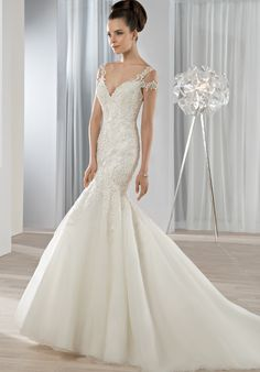 Fit n flare gown with V-neckline with a beaded lace and Organza skirt | Demetrios 610 | http://knot.ly/6495B7XhS