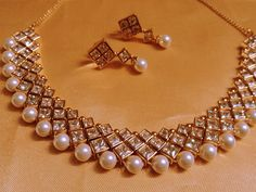 Shop Designer Pearl And Kundan Choker by Runjhun Jewellery online. Largest collection of Latest Necklaces online. Indian Jewelry Sets, Indian Wedding Jewelry, India Jewelry, Bridal Jewelry, Gold Jewelry, Jewelry Design Earrings, Necklace Designs, Jewelry Necklaces, Fancy Jewellery