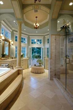 Don't know how I would ever use this bathroom with glass doors leading outside, but it is gorgeous!